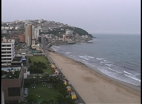 Haeundae Beach adorns the city of Bussan, South Korea Footage
