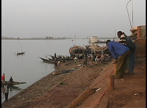 A medium-shot of longboats and people along the shores of... Stock Video Footage