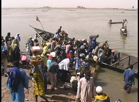 A birds-eye view of passengers leaving a long ferry boat... Stock Video Footage