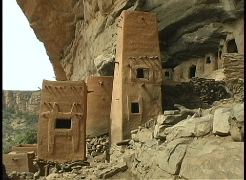 A lovely shot of the Tellem Ruins at the base of a large, dry mountain range in Africa Footage