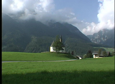 A small white church stands on a hilltop in an Austrian... Stock Video Footage