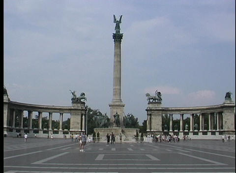 A medium-shot of tourists walking near Heroes' Square in... Stock Video Footage
