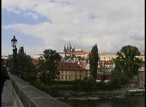 Tourists sightsee in Prague along a road that overlooks... Stock Video Footage