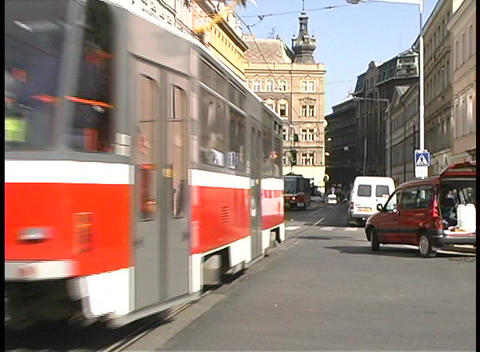 A medium-shot of streetcars and traffic on a city street... Stock Video Footage