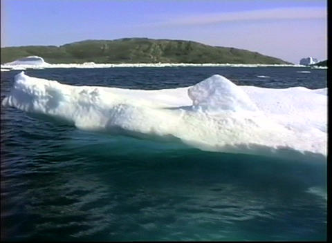 Camera zooms-out from a massive iceberg near Greenland Footage
