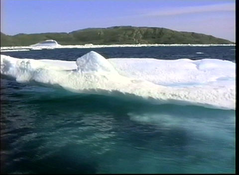 Camera zooms-out from a massive iceberg near Greenland Stock Video Footage