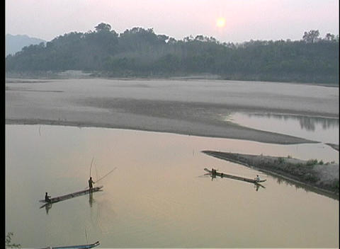Fishing during golden-hour along the Mekong River Stock Video Footage