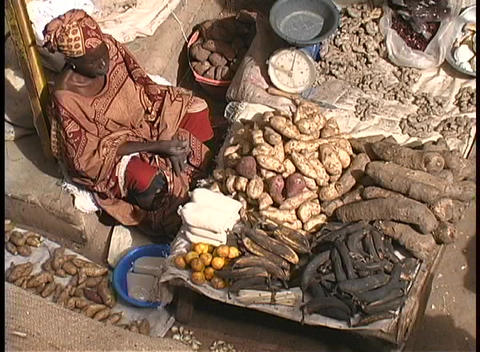 A vendor sells produce at an open market in Africa Stock Video Footage