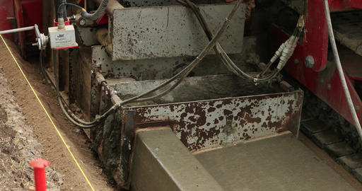 Concrete construction laying curb gutter DCI 4K Footage