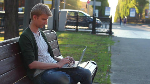 Man laptop turns seriously looks, success, victory, development Footage