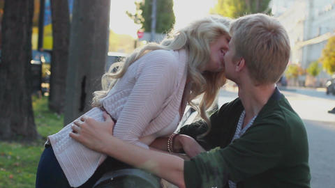 Young couple kissing on bench park, romantic date love relations Footage