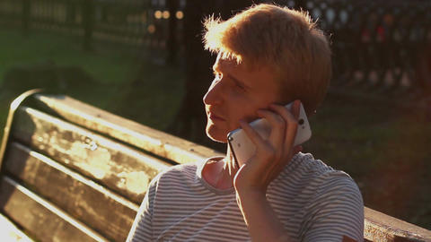 Young happy man calling talking over phone enjoying conversation Footage