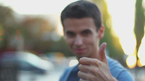 Young man thumb up, like, thumb-down, dislike gestures, wants Footage