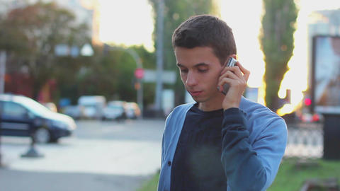 Man calls dials number no answer serious young male outdoors day Footage