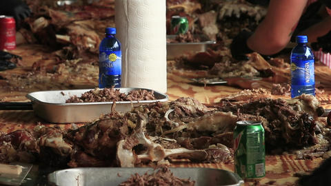 Cooked lamb pull from bone for town celebration lunch HD Footage
