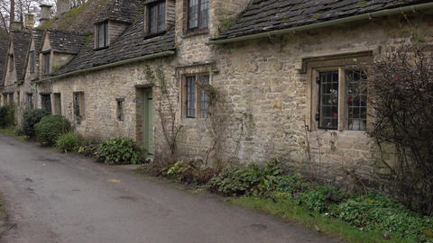 Cotswold Bibury England historic village cottages pan 4K Footage