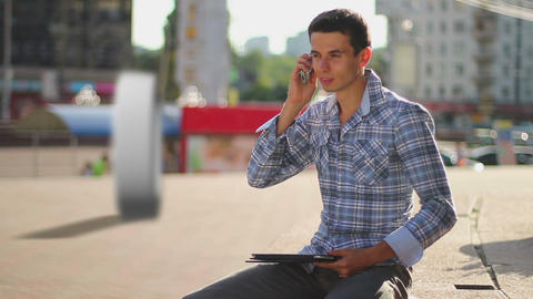 Zero calls concept, young man makes free calls mobile phone Live Action