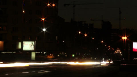 Night traffic on city wide road, cars leave traces with lights Footage