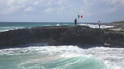 Cozumel Mexico flag on rocky beach 4K Footage
