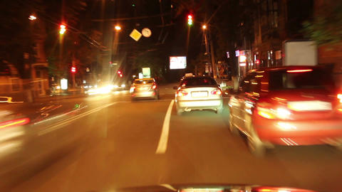 Driving night city car timelapse, streets fly, cars leave traces Footage