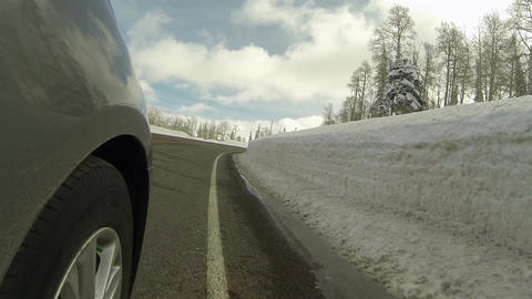 Drive mountain winter snow bank road wheel POV HD 0284 Footage