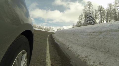 Drive mountain winter snow bank road wheel POV HD 0284 Footage
