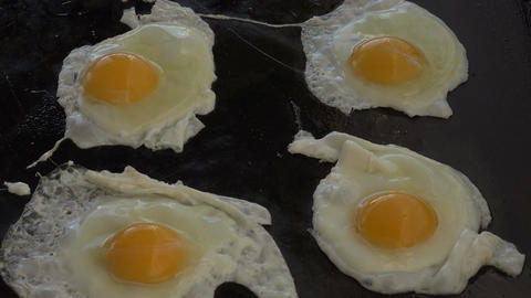 Eggs cooking on iron grill 4K 083 Footage