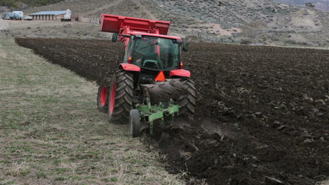 Farm field tractor plowing spring planting HD 2474 Footage