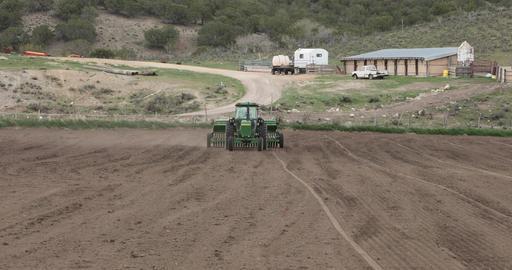 Farm tractor agriculture drilling alfalfa seeds springtime DCI 4K Footage
