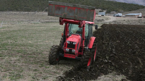 Farm tractor plowing field spring planting HD 2487 Footage