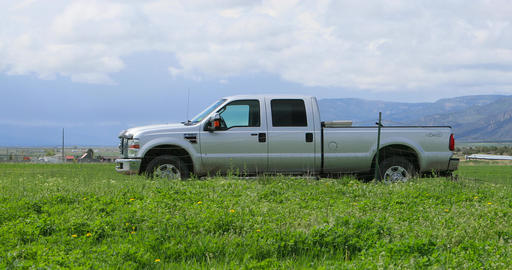 Farm truck parked in hay agriculture field DCI 4K Footage