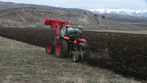 Farming farmer plowing field heavy duty tractor HD 2472 Footage