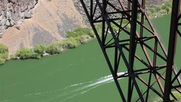 Fishing boat deep Snake River Gorge Idaho under Perrine Bridge HD 8114 Footage