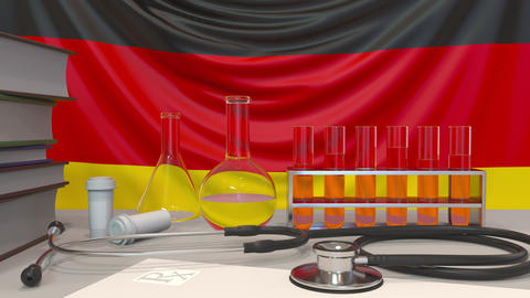 Clinic laboratory equipment on German flag background. Healthcare and medical Live Action