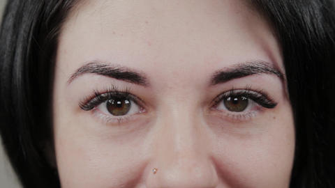Beautiful girl after permanent eyebrow makeup. Portrait of a young girl Live Action
