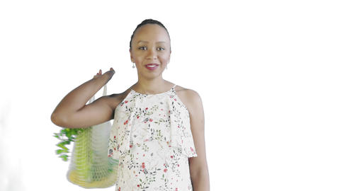 Attractive Afro american woman is holding reusable mesh string knitted shopping Live Action