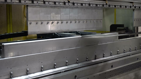 CNC bending machine. The machine bends the metal part Live Action