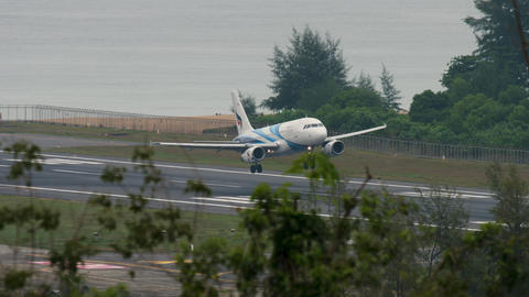 Airbus 320 approaching over ocean Live Action