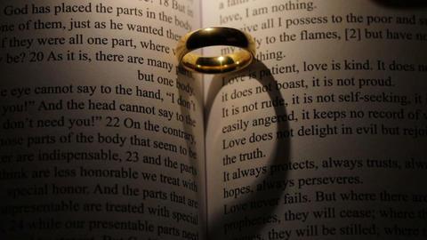 Golden wedding ring on bible book ライブ動画