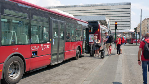 Tourists on the bus stop near Rome Termini station in summer Live Action