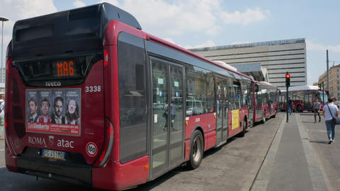 Red buses on the stop near Rome Termini station in summer Live Action
