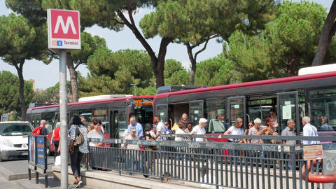 People on the bus stop near Rome Termini station in summer Live Action
