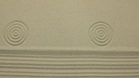Simple spiritual patterns in a japanese zen garden with concentric circles and Live Action
