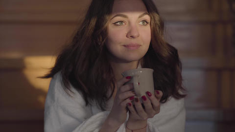 Portrait of attractive Caucasian brunette woman looking away and drinking coffee Live Action
