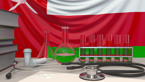 Clinic laboratory equipment on Omani flag background. Healthcare and medical Live Action