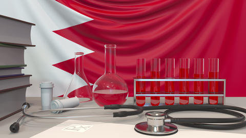 Clinic laboratory equipment on Bahraini flag background. Healthcare and medical Live Action