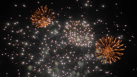 Colorful blurry fireworks in dark sky at night - holiday concept - slow motion ライブ動画