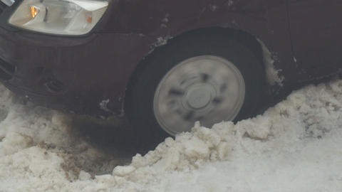 Car is stuck and slipping in the snow Live Action