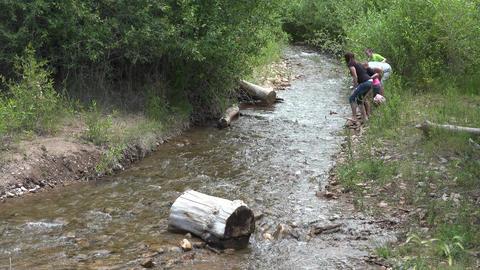 Grandkids floating homemade rafts mountain creek 4K Footage