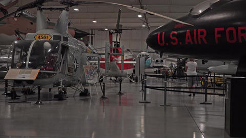 Historic military helicopters and aircraft Hill AFB Utah woman 4K Footage